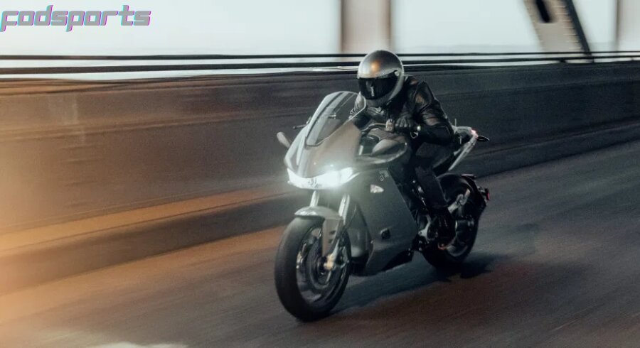 A motorcycle rider is riding fast on the highway