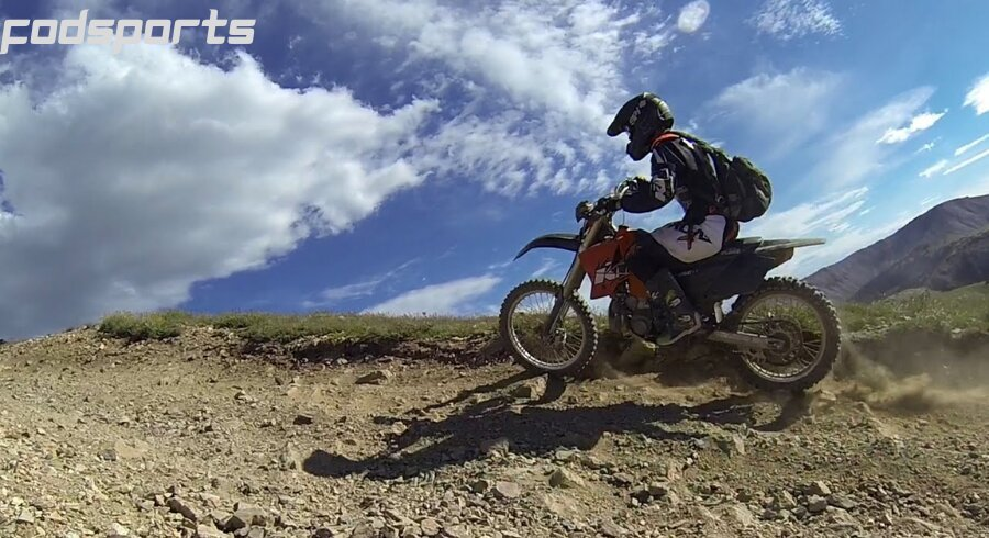 A motorcycle rider enjoys riding in the wild