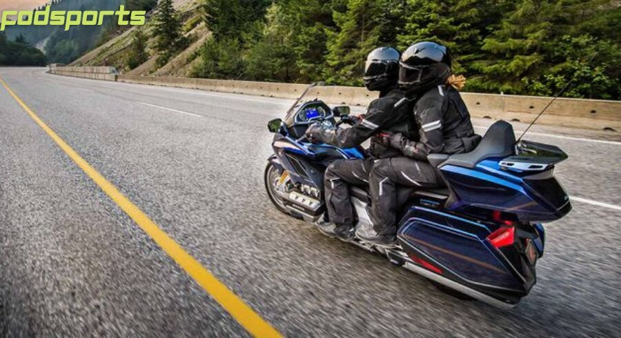 A pair of riders enjoy motorcycle riding on the road