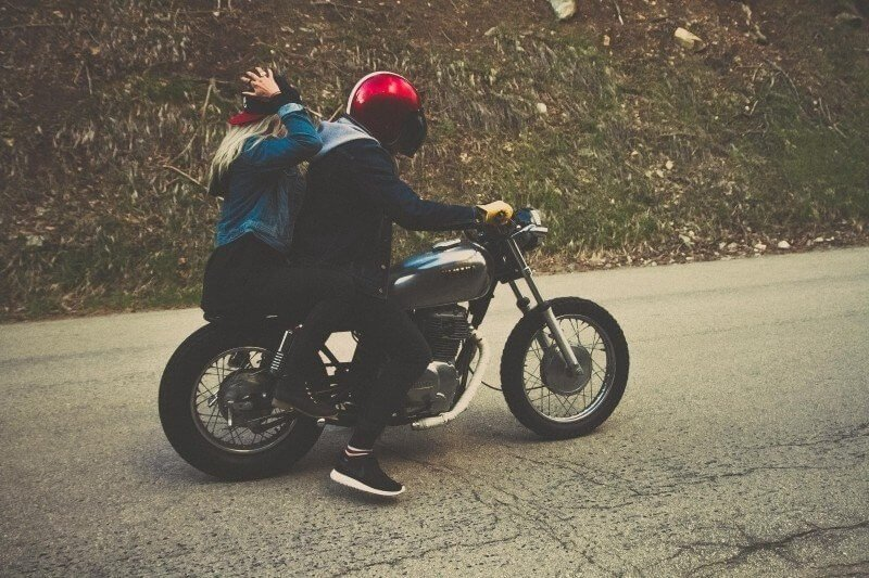 Young riders and motorcycle passenger