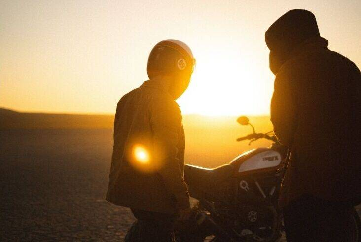 Two riders in the sunset