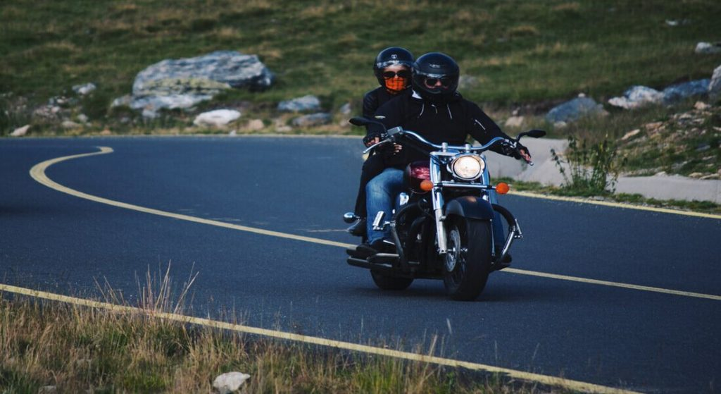 motorcycle driver and motorcycle passenger on the road