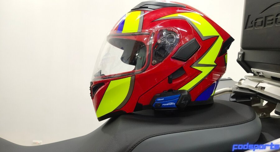 A Helmet Equipped With A Bluetooth Intercom Is Placed On The Motorcycle