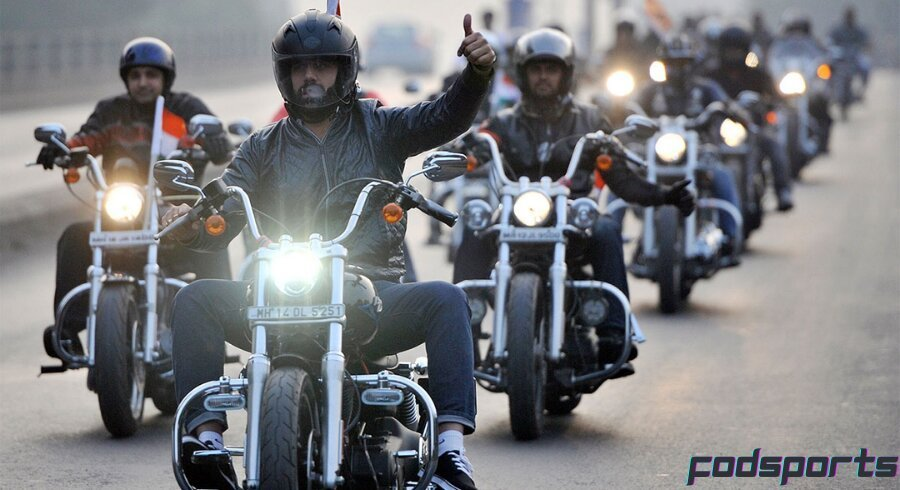 A group of motorcyclists riding on the road